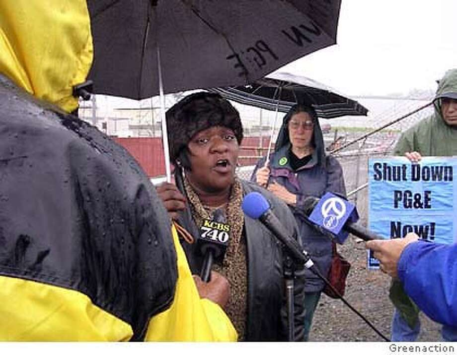 Marie Harrison as the Hunter's Point Power Plant's arch-nemesis: protesting the plant's continued operation in December 2004. Photo by Greenaction