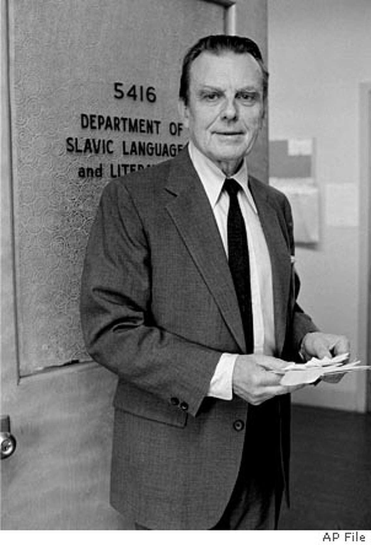 *** FILE *** Nobel Prize winner for literature Czeslaw Milosz poses at his office at the University of California in this Thursday, Oct. 10, 1980 file photo. The Polish poet and Nobel laureate Czeslaw Milosz, known for his intellectual and emotional works about some of the worst cruelties of the 20th century, died Saturday, the Polish news agency PAP reported. He was 93. (AP Photo)
