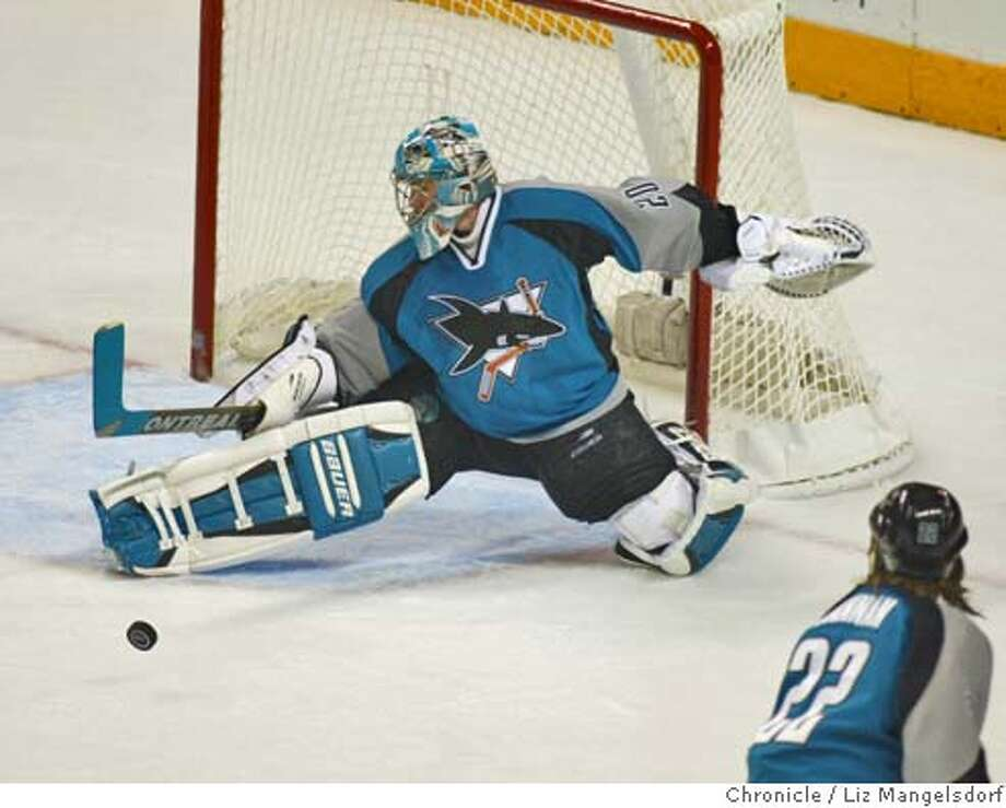 A69C6089.JPG Event on 5/11/04 in San Jose.  Sharks goalie Evgeni Nabokov block a shot in the first period. San Jose Sharks play tht Calgary Flames in game two of the playoffs at san jose.  Liz Mangelsdorf / The Chronicle Photo: Liz Mangelsdorf