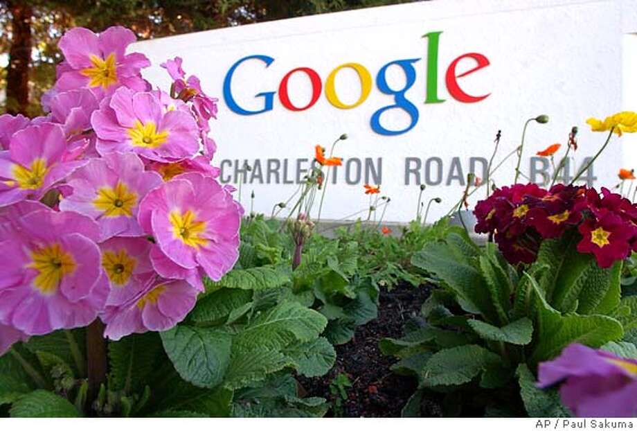 Flowers bloom in front of Google Inc. headquarters in Mountain View, Calif., Tuesday, Feb. 1, 2005. Google Inc.'s Internet-leading search engine fueled a sevenfold increase in fourth-quarter profits to soar past analyst expectations. The Mountain View-based company said Tuesday, Feb. 1, 2005, that it earned $204.1 million, or 71 cents per share, during the final three months of 2004. That compared to net income of $27.3 million, or 10 cents per share, at the same time in 2003. (AP Photo/Paul Sakuma) Photo: PAUL SAKUMA