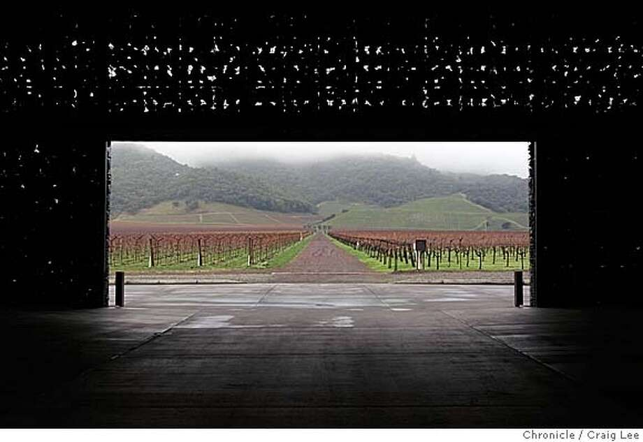 Christian Mouiex, who directs Chateau Petrus in Bordeaux, Dominus in Yountville, Napa Valley and many other brands for his French winemaking family. This photo was taken at Dominus winery in Yountville. Photo looking out from the winery towards the vineyard.  Event on 12/10/04 in Yountville. Craig Lee / The Chronicle Photo: Craig Lee