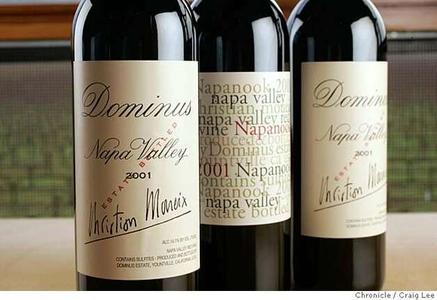 Photo of 2001 Dominus Napa Valley with a bottle of 2001 Napanook Napa Valley. Christian Mouiex, who directs Chateau Petrus in Bordeaux, Dominus in Yountville, Napa Valley and many other brands for his French winemaking family. This photo was taken at Dominus winery in Yountville.  Event on 12/10/04 in Yountville. Craig Lee / The Chronicle Photo: Craig Lee
