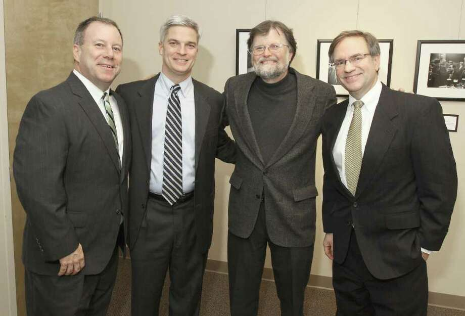 Albany, NY - January 19, 2012 - (Photo by Joe Putrock/Special to the Times Union) - Irish American Heritage Museum Board Chair Edward Collins(2nd from right) poses with Bill Flynn(left), Dave Flanagan(2nd from left) and Paul Powers(right) during the Irish American Heritage Museum Grand Opening Reception to benefit the Museum. Photo: Joe Putrock / Joe Putrock