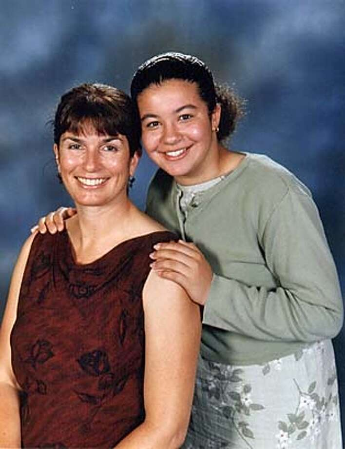 This is an undated photo of photographer Susan Caldwell and her 14-year-old daughter Nina Garrison provided by the Examiner. Caldwell and her daughter were killed Sunday, Jan. 30, 2005 in San Francisco when a van heading downhill smashed into their sedan, causing the vehicle to flip over, police said. Caldwell died instantly, while her daughter was pronounced dead at San Francisco General Hospital several hours later. Caldwell worked for many years for the Independent newspapers, which eventually became part of the company that owned the Examiner. Current and former colleagues described her as a dedicated photojournalist. (AP Photo/The Examiner)