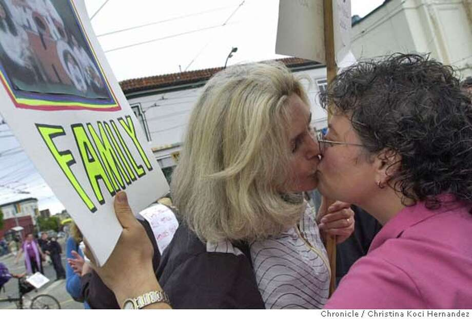 (R)Sallyanne Monti and(L) Mickey Neill join the rally in the Castro top protest the ruling, and kiss after they pledged to fight for their rights. Sallyanne Monti and Mickey Neill have been together for many years and have four kids. They and their two teenagers, Frank13, and Alyssa,15, react to the news from the supreme court, invalidating their marriage. CHRISTINA KOCI HERNANDEZ/CHRONICLE Photo: CHRISTINA KOCI HERNANDEZ