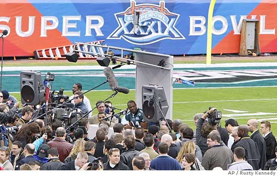 Philadelphia Eagles wide receiver Terrell Owens is surrounded by a throng of reporters during the annual Media Day at Alltel Stadium in Jacksonville, Fla., on Tuesday, Feb. 1, 2005. Owens says he is prepared play against the New England Patriots in Super Bowl XXXIX this Sunday. (AP Photo/Rusty Kennedy) Photo: RUSTY KENNEDY