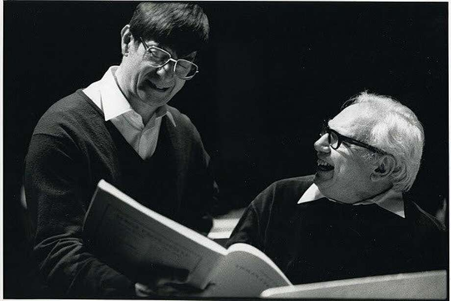 Violinist Isaac Stern and San Francisco Symphony Music Director Herbert Blomstedt in London, 1987. Stern, violin soloist on the 1987 Europen tour, confers with Blomstedt about Prokofiev's Violin Concerto No. 1 Photo: Mary Robert