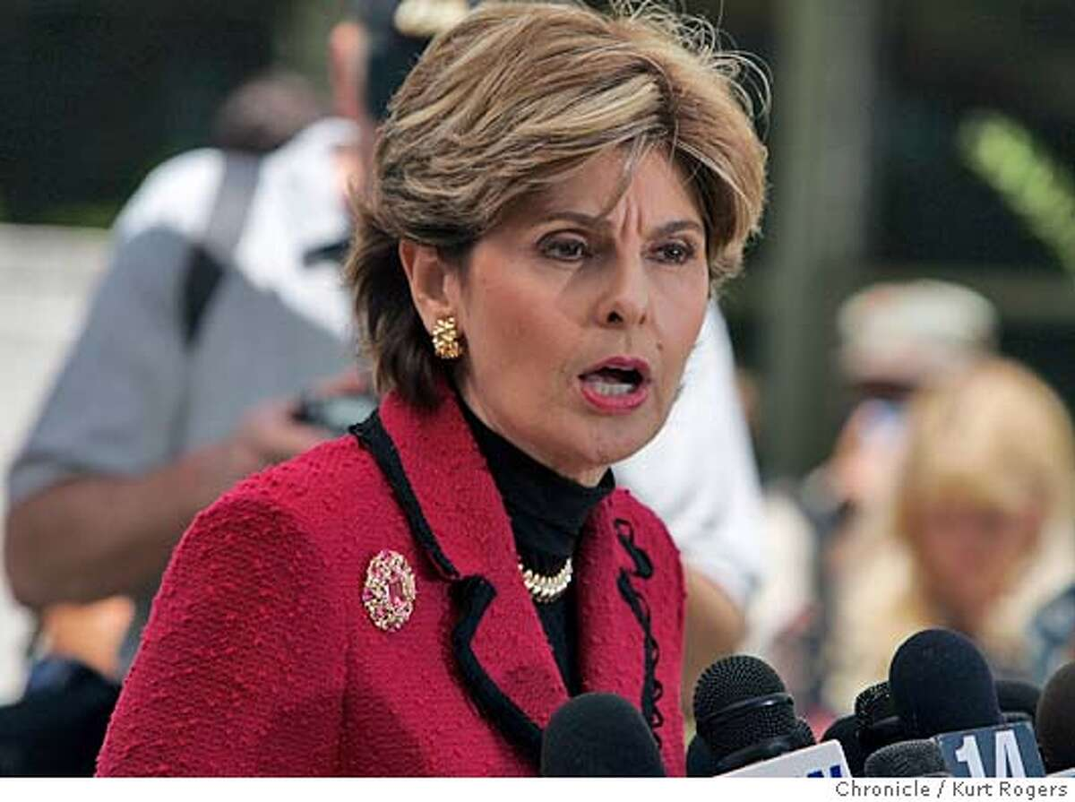 Gloria Allred talks with the media during a brake in the trial. Out side the court house in Redwood City waiting for Amber Frey to testify in the murder trial of Lacy Peterson. 7/10/04 in Redwood City,CA. Kurt Rogers/The Chronicle