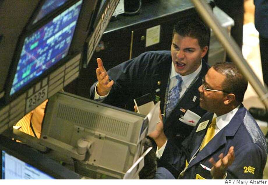Traders react to the numbers shortly after the opening bell at the New York Stock Exchange, Thursday, Aug. 12, 2004 in New York. Disappointing earnings from Hewlett-Packard Co. and another spike in crude oil prices pushed stocks lowerThursday. (AP Photo/Mary Altaffer) Photo: MARY ALTAFFER