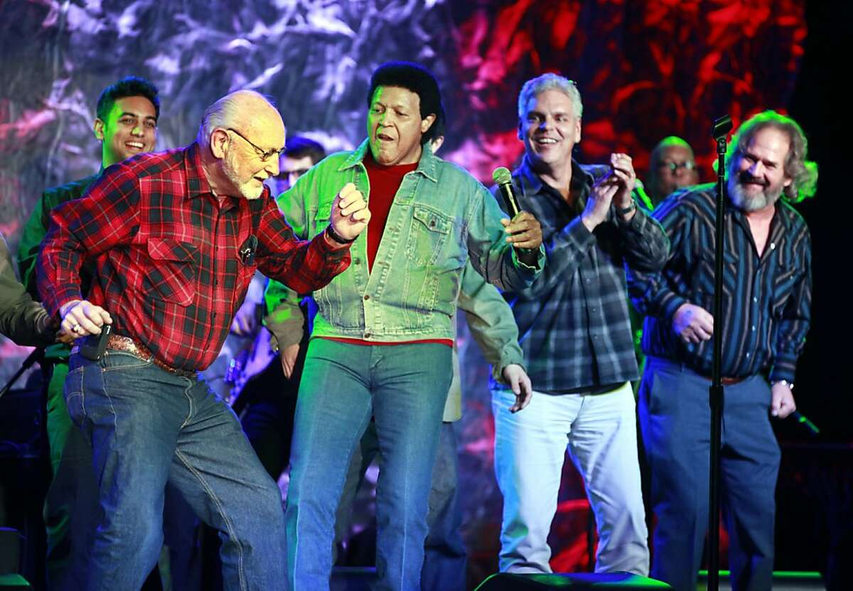 Singer-composer Chubby Checker center performs his twist with male members of the audience on the eve of the song's 50th anniversary at Thunder Valley Casino Friday, January 6, 2012