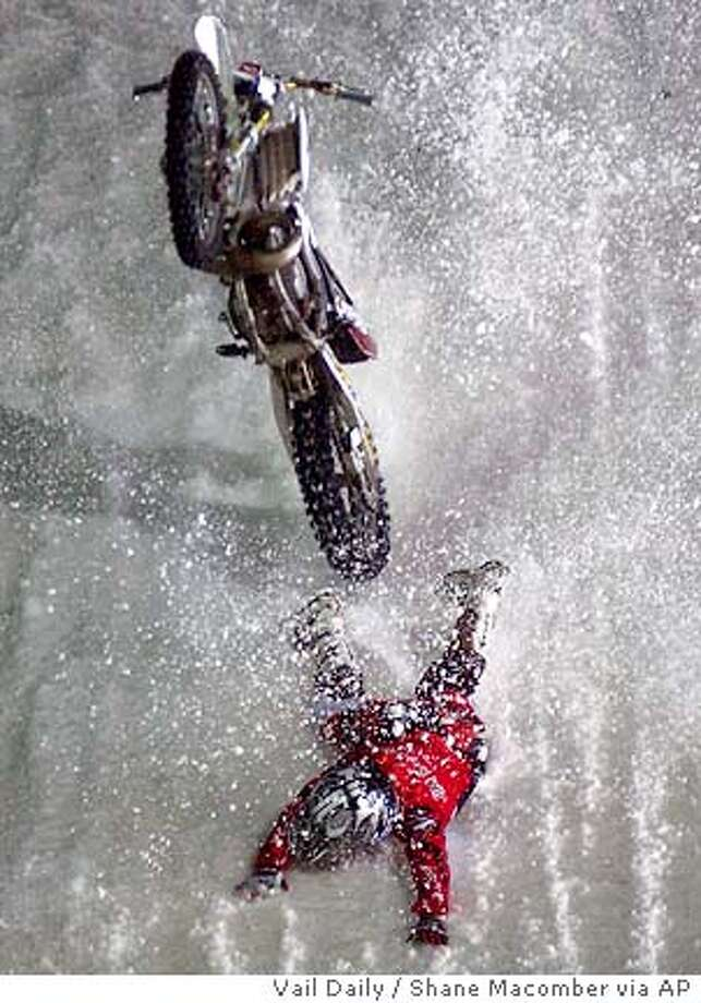 Jim McNeil, of Phoenix, Ariz., crashes Saturday Jan. 29, 2005, during motoX best trick practice at Winter in Aspen, Colo. McNeil walked away under his own power. (AP Photo/Vail Daily, Shane Macomber) Photo: SHANE MACOMBER