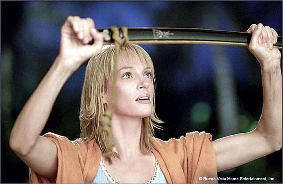 DVDlist-KillBill13.jpg Uma Thurman in KILL BILL 2 HANDOUT