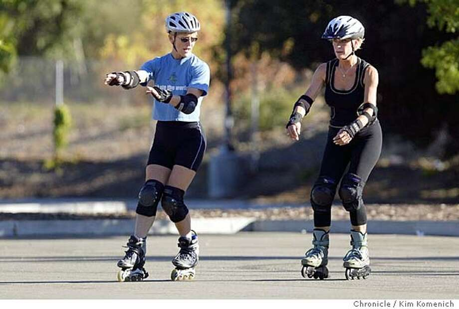Liz Miller, L, instructs Joann Boccolini (cq cq) of Benicia.  Liz Miller is a 52 year-old breast cancer survivor who teaches rollerblading in her Danvill Recreational Center class and has written three books on the subject. We photograph her teaching individual classes at the Sycamore Blvd. Park and Ride lot in Danville. Photo by Kim Komenich in Danville Photo: Kim Komenich