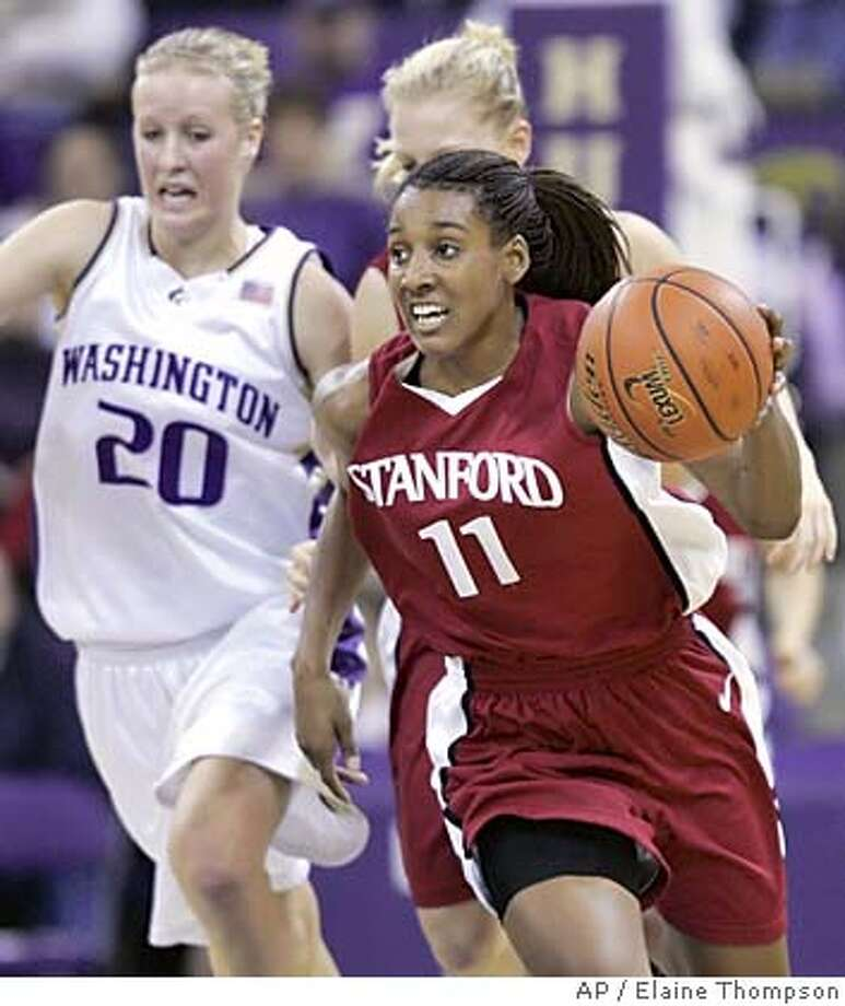 Stanford's Candice Wiggins (11) drives upcourt in front of Washington's Kayla Burt (20) in the second half Thursday, Jan. 27, 2005, in Seattle. The freshman standout Wiggins added 10 of her 12 points in the second half to help No. 4 Stanford pull away from Washington for an 82-60 victory. (AP Photo/Elaine Thompson) Photo: ELAINE THOMPSON