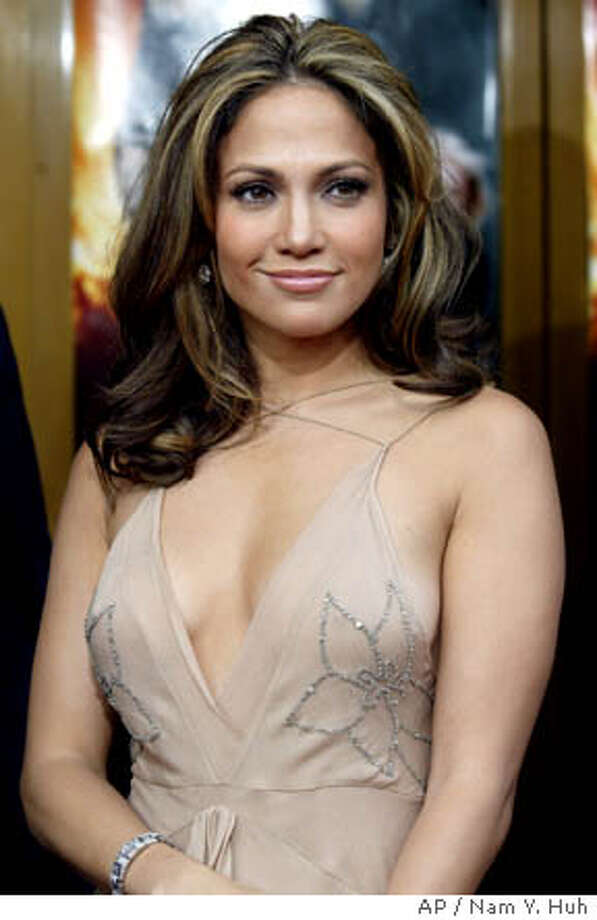 "**FILE**Actress and singer Jennifer Lopez poses for a photo as she arrives for the world premiere of Man on Fire in this April 18, 2004 file photo, in Los Angeles. In early June, Lopez reportedly married singer Marc Anthony in a small ceremony at her Beverly Hills, Calif., home. All she'll say about Anthony is, ""We have a great working relationship. I have to keep my work and my personal life separate. Otherwise it gets blurry and it gets messy.""(AP Photo/ Nam Y. Huh) Photo: NAM Y HUH"