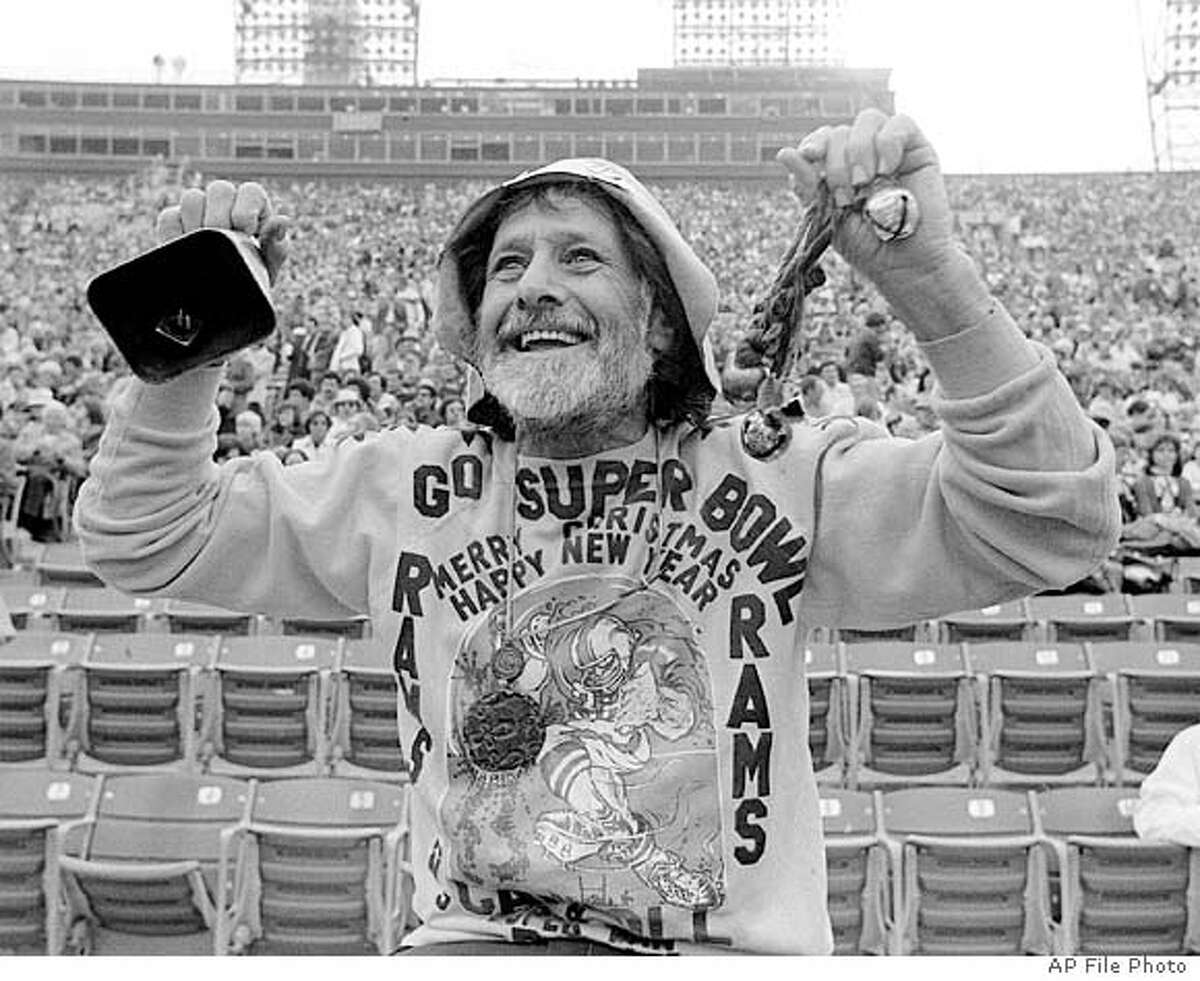 **FILE** Gypsy Boots cheers on the Los Angeles Rams in this Dec. 1977 file photo in Los Angeles. Gypsy Boots, a California fitness icon, author and health guru who paved the way for generations of beatniks, hippies and health-food junkies, died Sunday Aug. 8, 2004. He was 89. (AP Photo/File) A DECEMBER, 1977 FILE PHOTO. BLACK AND WHITE ONLY.