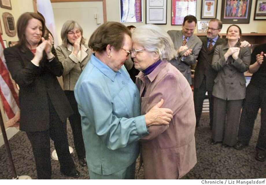 A69C0585.JPG  Phyllis Lyon, left, and Del Martin, who have been together for 51 years, embrace after their marriage at city Hall. They are the first legally married same-sex couple in San Francisco. In the background from left are Kate Kendell, Executive director of the National Center for Lesbian Rights, and Roberta Achtenberg, Senior Vice President of the San Francisco chamber of Commerce. In the background on the right are members of Mayor Gavin Newsom's staff, including Steve Kawa, center, chief of Staff and Joyce Newstat, Director of Policy, far right..  The first legally married same-sex couple in San Francisco are married by City assessor/Recorder mabel Teng in her office at City Hall. Phyllis Lyon and Del Martin, who have been together for 51 years say their vows.  LIZ MANGELSDORF/ The Chronicle Photo: LIZ MANGELSDORF