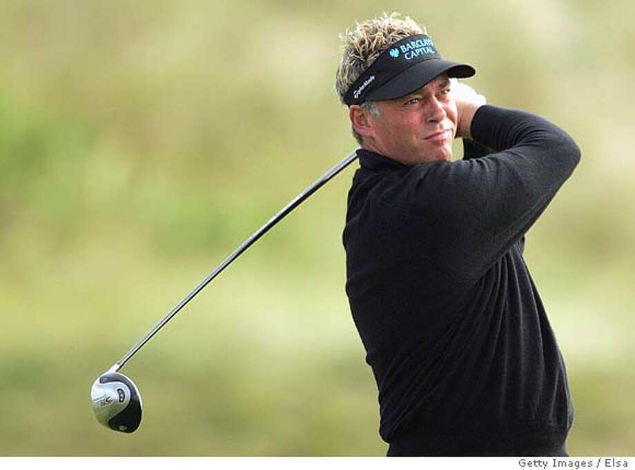 KOHLER, WI - AUGUST 12: Darren Clarke of Northern Ireland watches his shot from the second tee during the first round of the U.S. PGA Championship at the Whistling Straits Golf Course on August 12, 2004 in Kohler, Wisconsin. (Photo by Elsa/Getty Images) *** Local Caption *** Darren Clarke Photo: Elsa