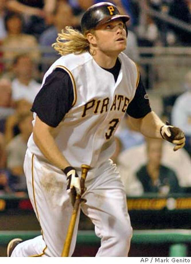 Pittsburgh Pirates' Craig Wilson watches his game-winning two-run home run off San Francisco Giants reliever Dustin Hermanson in the 11th inning Wednesday, Aug. 11, 2004 in Pittsburgh. The Pirates beat the Giants 8-6. (AP Photo/Mark Genito) Photo: MARK GENITO