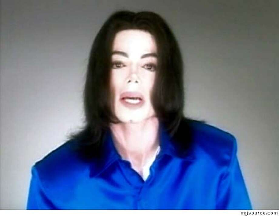 "Michael Jackson speaks in this video released on his website January 30, 2005. In a court-approved video statement released on his web site, Jackson said: ""In the last few weeks, a large amount of ugly, malicious information has been released into the media about me. The information is disgusting and false."" ""Please keep an open mind and let me have my day in court,"" Jackson added. ""I deserve a fair trial like every other American citizen. I will be acquitted and vindicated when the truth is told."" (NO ARCHIVES, EDITORIAL USE ONLY) REUTERS/HO/mjjsource.com Photo: HO"