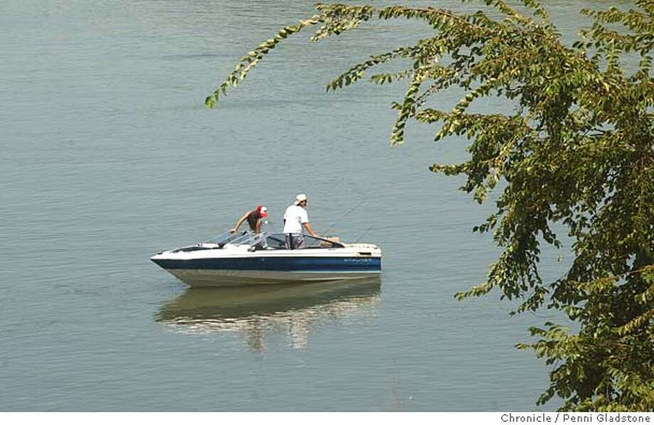 BOATERs fishing and sunning on the idelic Sacramento River. It was hotter than heck as people escaped on a weekday to the water.  8/10/04 in Sacramento.  Penni Gladstone / The Chronicle Photo: Penni Gladstone