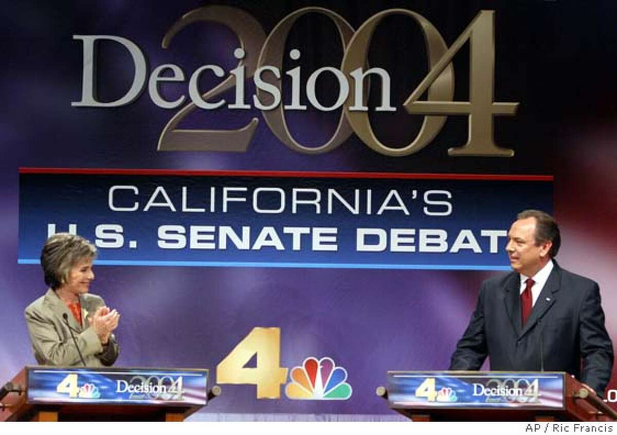 Sen. Barbara Boxer, D-Calif., and her Republican challenger Bill Jones acknowledge each other at the start of the League of Women Voters' senatorial debate in Los Angeles Tuesday, Aug. 10, 2004. (AP Photo/Ric Francis)