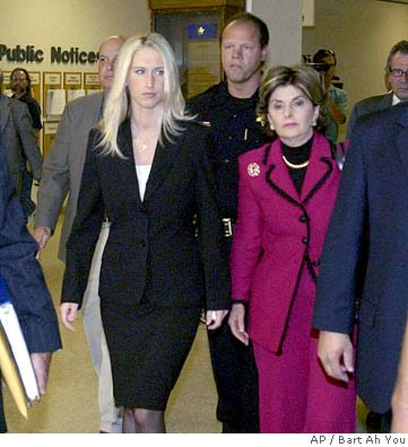 Amber Frey, mistress of murder suspect Scott Peterson, leaves the San Mateo County Superior Court in Redwood City, Calif., Tuesday, Aug. 10, 2004, after testifying in Peterson's double homicide trial. Scott Peterson is being tried and could faced the death penalty if he's convicted of two counts of murder for the deaths of his wife, Laci, and the couple's unborn son. (AP Photo/Bart Ah You, Pool) POOL PHOTO Photo: BART AH YOU POOL