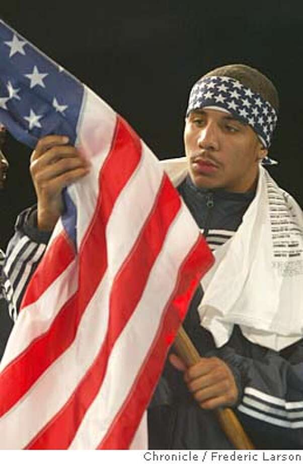 ; Trape in old Glory before the match, Andre Ward of Oakland California duels with John Dovi of France during a Olympic-style boxing duel between team USA and team France in Reno Saturday night November 1, 2003. He when on to win the match by one point. FREDERIC LARSON / The Chronicle Photo: FREDERIC LARSON
