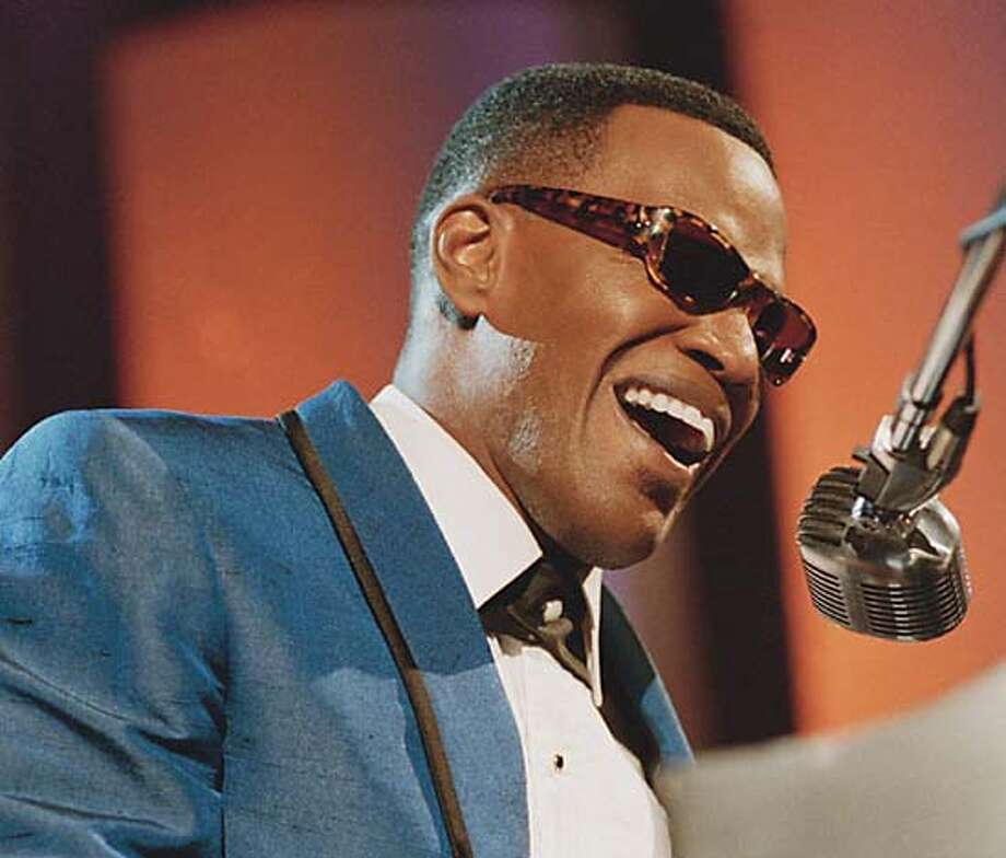 "**FILE**In this undated file picture recently supplied photo from Universal Pictures, Jamie Foxx portrays musician Ray Charles in this scene from Universal Pictures' ""Ray."" Foxx took the top male acting honors for the film from the National Board of Review, whose honors list was announced Wednesday, Dec. 1, 2004. (AP Photo/ Universal Pictures, Nicola Goode) Ran on: 12-19-2004  Jamie Foxx as Ray Charles in &quo;Ray&quo;: Was the movie underrated? UNDATED, Photo: NICOLA GOODE"