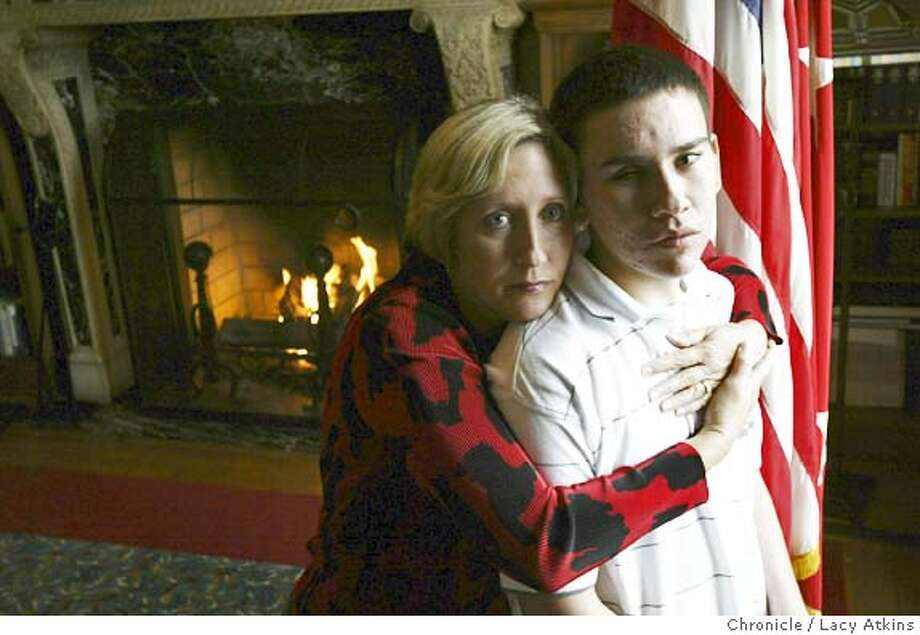 PFC Paul Hizo, an injured marine, with mother Donna Hanes, at the Marines Memorial Club, Aug.10,2004, in San Francisco. They 're family was assisted by the Injured Marine Semper Fi Fund,which was started by Karen Guenther and Liz Quist, designed to Marines� families while they are helping their Marines. LACY ATKINS / The Chronicle Photo: LACY ATKINS