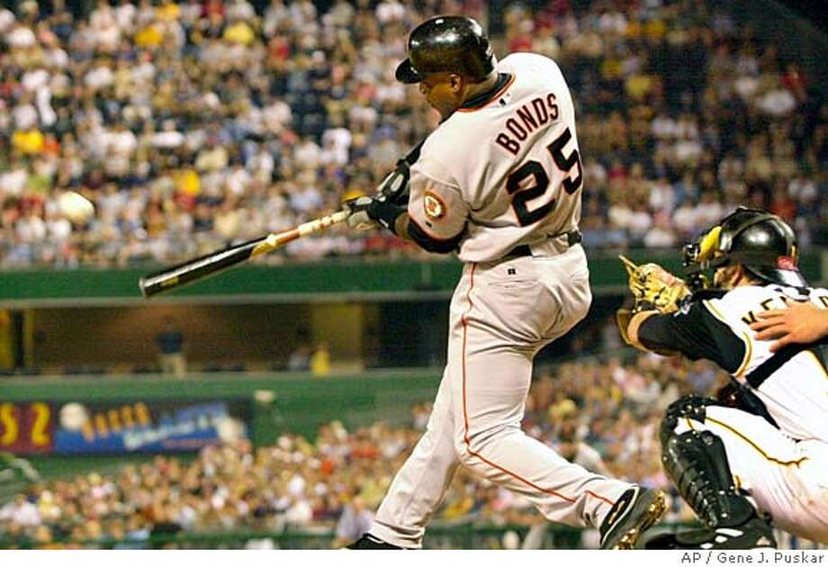 San Francisco Giants Barry Bonds (30) hits a home run off ittsburgh Pirates releiver John Grabow in the seventh inning Tuesday, Aug. 10, 2004 in Pittsburgh. Catching is Pirates Jason Kendall.(AP Photo/Gene J. Puskar) Photo: GENE J. PUSKAR