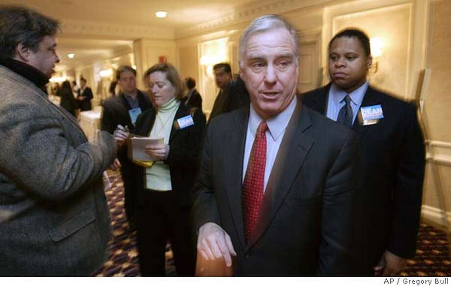 Howard Dean, second from right, makes his way through the crowd before a Democratic National Committee meeting introducing Dean and other candidates for DNC Chairman in New York Saturday, Jan. 29, 2005. (AP Photo/Gregory Bull) Photo: GREGORY BULL
