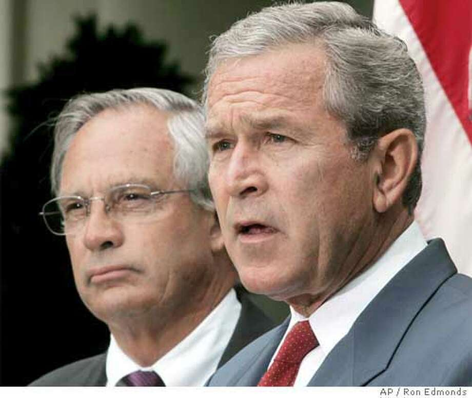 President Bush speaks in the Rose Garden, Tuesday, Aug. 10, 2004, along with Rep. Porter Goss, R-Fla., left, after he picked Goss, head of the House intelligence committee, to be the new director of the CIA. (AP Photo/Ron Edmonds) Photo: RON EDMONDS