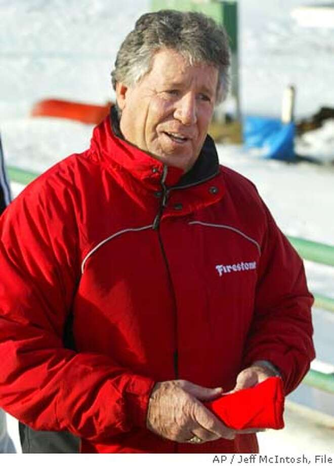 Former race car driver Mario Andretti smiles after riding a bobsled in Calgary, Wednesday, Jan. 19, 2005. Andretti was in the city promoting tires and wanted to try boblsedding. (AP Photo/Jeff McIntosh) Photo: JEFF MCINTOSH