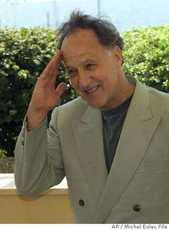 "HERZOG-C-12AUG02-DD-AP --- German director Werner Herzog gives a military salute to photographers during a photocall for this film ""Mein Liebster Feind"" (My Dear Enemy), out of competition, at the 52nd Cannes Film Festival in Cannes, France, Sunday, May 16, 1999.(AP PHOTO/Michel Euler) CAT"