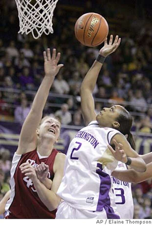 Washington's Cheri Craddock (2) reaches for a rebound in front of Stanford's Kristen Newlin in the first half Thursday, Jan. 27, 2005, in Seattle. (AP Photo/Elaine Thompson) Photo: ELAINE THOMPSON