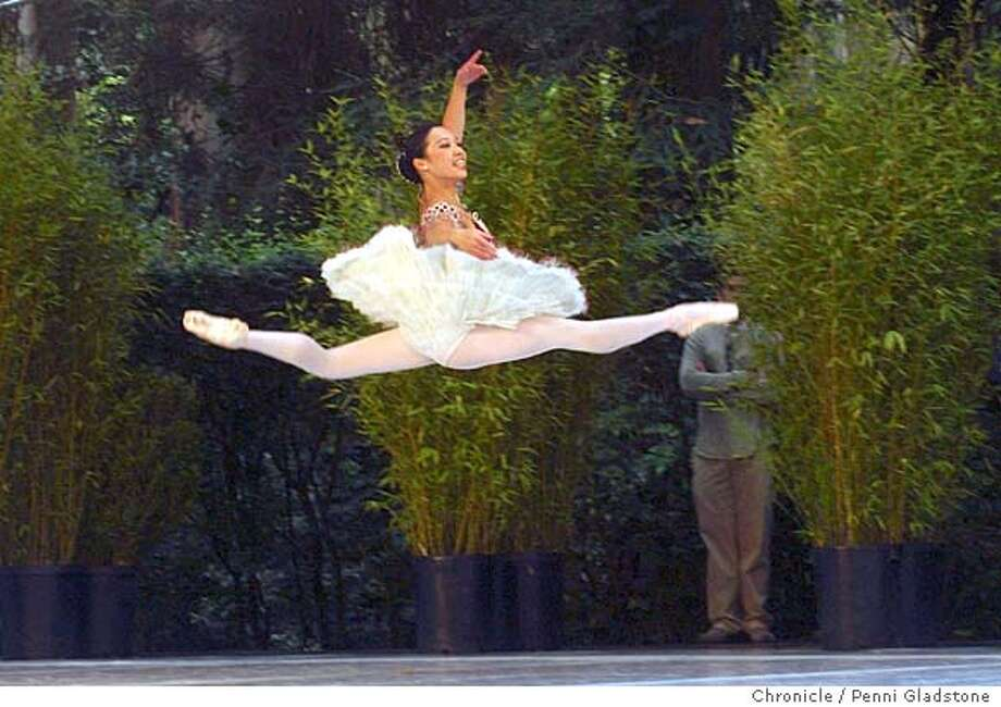 Frances Chung flies thru the air during Paquita.  SF BALLET show at Stern Grove.  8/8/04 in San Francisco.  Penni Gladstone / The Chronicle Photo: Penni Gladstone
