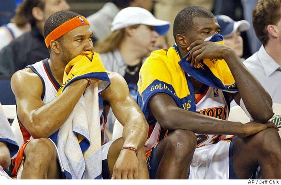 Golden State Warriors' Derek Fisher, left, and Jason Richardson sit on the bench in the fourth quarter against the New Jersey Nets in Oakland, Calif., on Wednesday, Jan. 26, 2005. The Nets won 113-99. Richardson led all scorers with 31 points. (AP Photo/Jeff Chiu) Photo: JEFF CHIU