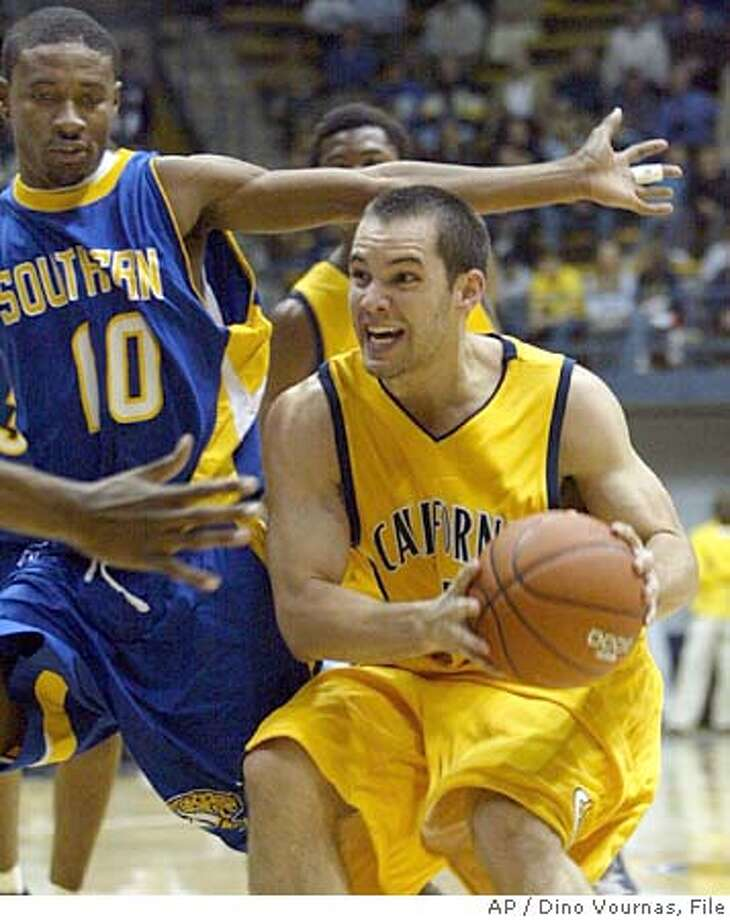 California's Richard Midgley, right, drives against Southern's Chris Alexander (10) in the second half, Tuesday, Nov. 23, 2004, in Berkeley, Calif. Midgley was the game's high scorer with 26 points. (AP Photo/Dino Vournas) Photo: DINO VOURNAS