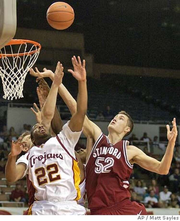 Stanford's Matt Haryasz, right, and Southern California's Errick Craven go up for a rebound during the second half in Los Angeles on Saturday, Jan. 22, 2005. Stanford won 78-70. (AP Photo/Matt Sayles) Photo: MATT SAYLES