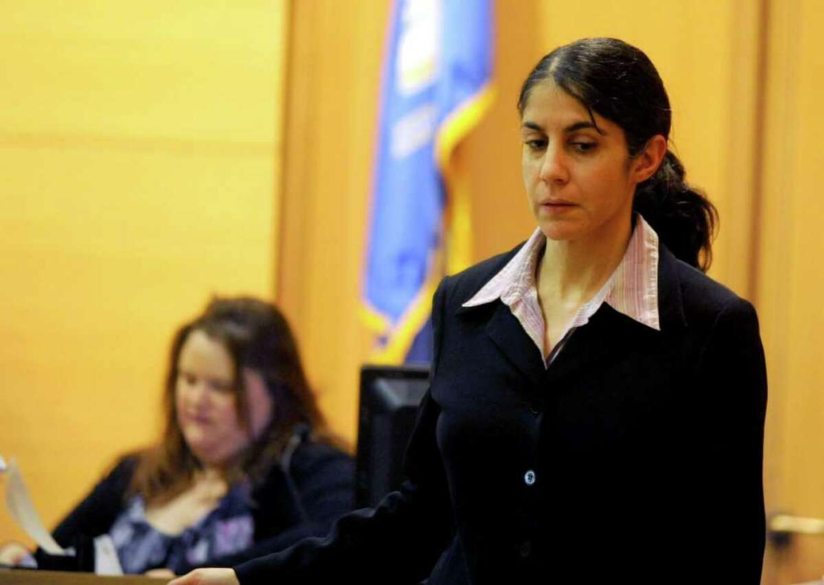 Sheila Davalloo questions Nelson Sessler during her murder trial before Superior Court Judge Richard Comerford at the Connecticut Superior Court building in Stamford, Conn. Jan. 26, 2012. Davalloo, who allegedly murdered Anna Lisa Raymundo in 2002, is representing herself in the trial.
