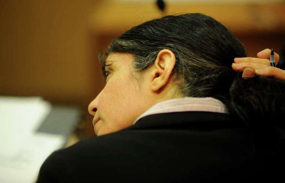 Sheila Davalloo who is representing herself at her murder trial before Superior Court Judge Richard Comerford at the Connecticut Superior Court building in Stamford, Conn. Jan. 26, 2012. Davalloo, allegedly murdered Anna Lisa Raymundo in 2002. Photo: Lindsay Niegelberg / Stamford Advocate