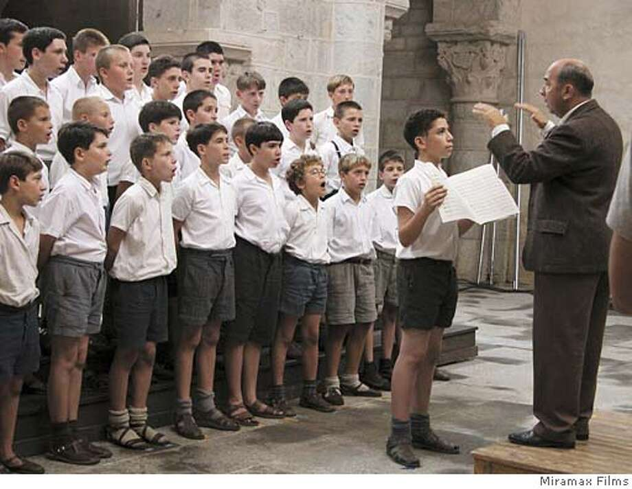 CHORUS28_01.JPG 41 Gerard Jugnot, who portrays teacher Clement Mathieu, is conducting the boys of �Fond De L�Etang� choir in Miramax Films� and Jacques Perrin�s �The Chorus (Les Choristes). Photo Credit: Photo Courtesy of Miramax Films.