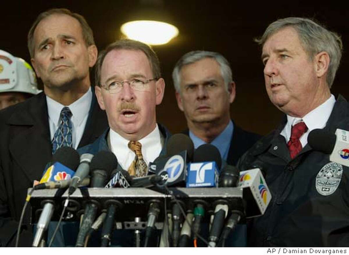 Officials from left: Glendale Police Chief Randy Adams, Special Agent in Charge of the Criminal Division of the Federal Bureau of Investigations Jim Sheehan, Los Angeles Mayor James Hahn, and Los Angeles Attorney Steve Cooley, take questions from the media during a news conference Wednesday, Jan. 26, 2005, in Glendale, Calif. A suicidal man parked his SUV on the railroad tracks and set off a crash of two commuter trains Wednesday that hurled passengers down the aisles and turned rail cars into smoking, twisted heaps of steel, authorities said. At least 10 people were killed and more than 180 injured. The SUV driver got out at the last moment and survived. (AP Photo/Damian Dovarganes)
