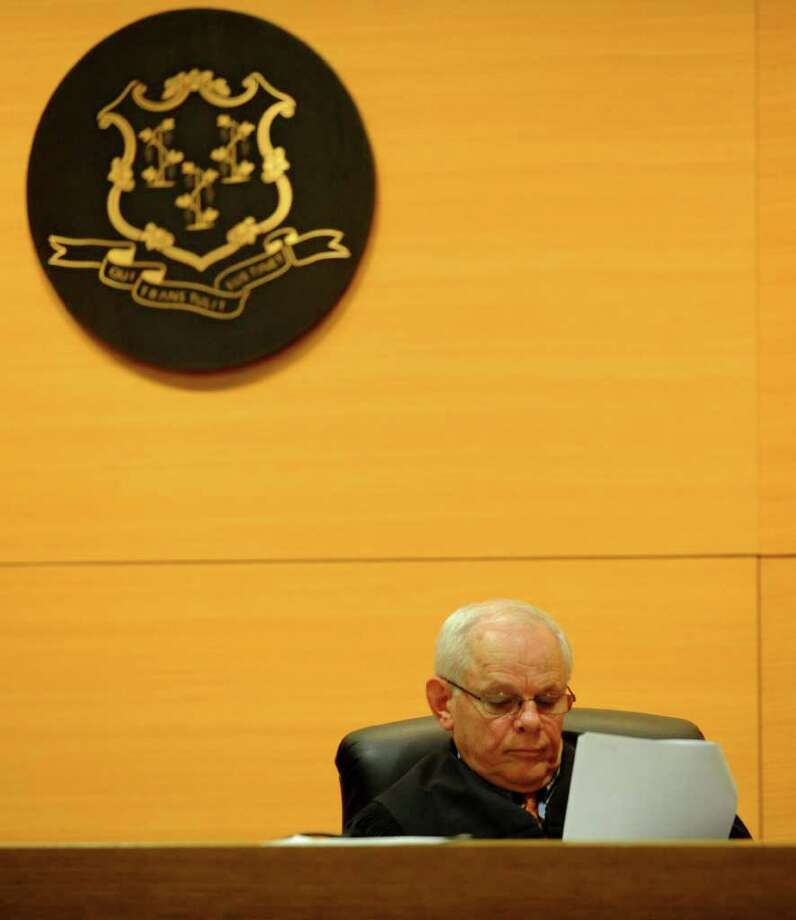 Judge Richard Comerford reads a transcript as the corresponding audio recording plays during the murder trial of Sheila Davalloo at the Connecticut Superior Court building in Stamford, Conn. on Jan. 26, 2012. Davalloo, who allegedly murdered Anna Lisa Raymundo in 2002, is representing herself in the trial. Photo: Lindsay Niegelberg / Stamford Advocate