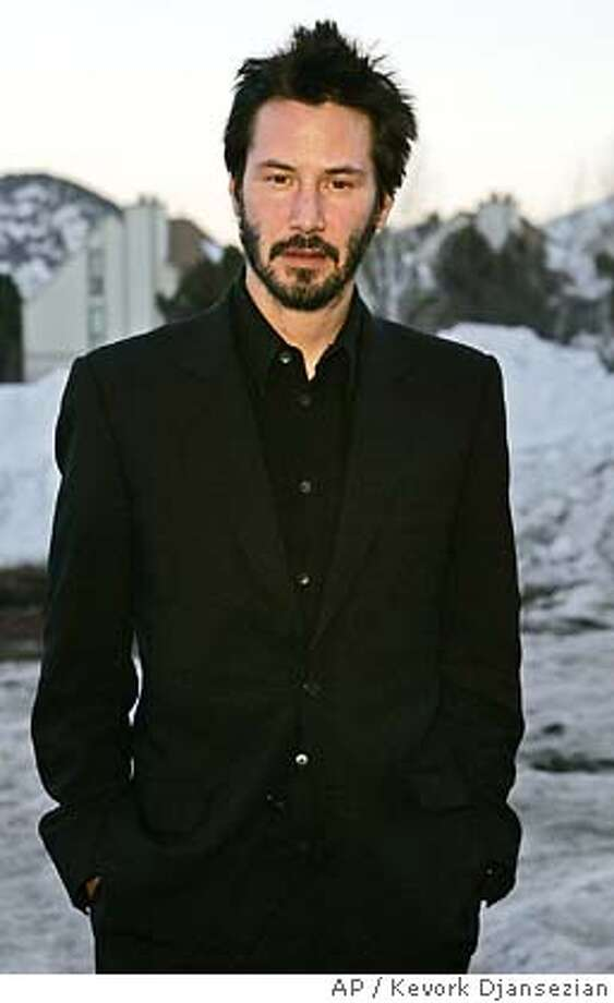 "Keanu Reeves star of the film ""Thumbsucker"" arrives to the premiere of the film Sunday, Jan. 23, 2005, at the Sundance Film Festival in Park City, Utah. (AP Photo/Kevork Djansezian) Photo: KEVORK DJANSEZIAN"