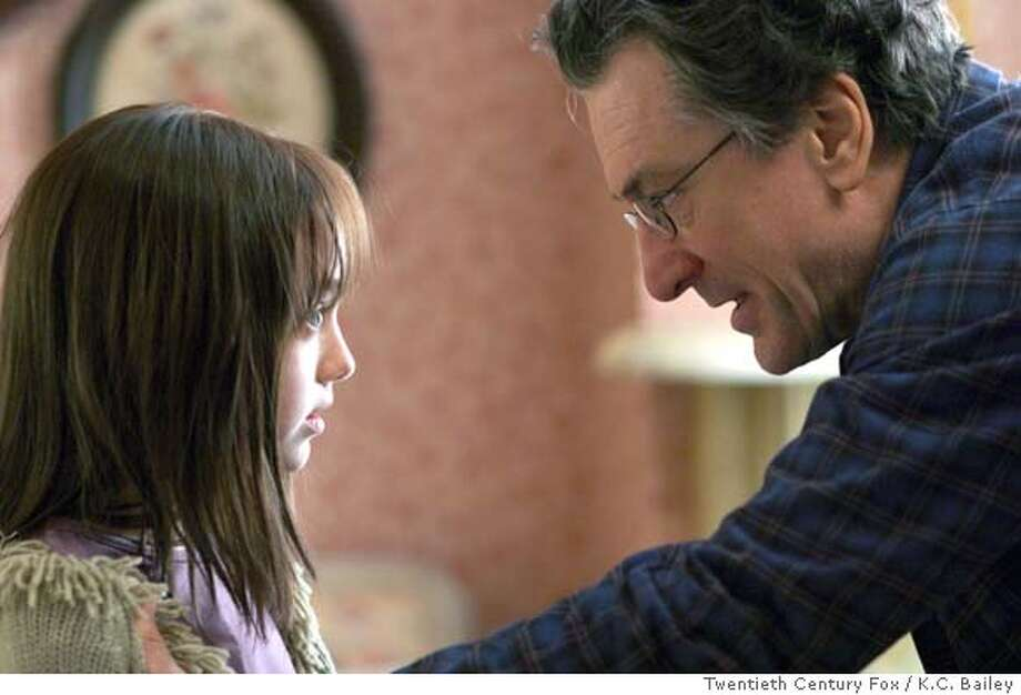 """In this photo provided by Twentieth Century Fox, David Callaway ( Robert De Niro) tries to get at the truth behind his daughter Emilys (Dakota Fanning) imaginary friend in """"Hide and Seek."""" (AP Photo/Twentieth Century Fox/K.C. Bailey) Photo: KC BAILEY"""
