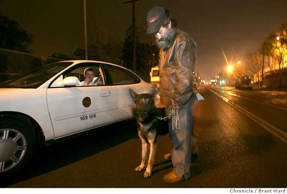 55 year old homeless man Joel Gannon and his German Shepherd named El Cid were counted by San Francisco homeless policy director Trent Rhrorer (chk spell please) as he drove around near SBC Park.  San Francisco held it's bi-annual count of the homeless population Tuesday night. Over 200 volunteers gathered for a meeting and then took their maps and their clipboards and counted the homeless in the city.  Brant Ward 1/26/05 Photo: Brant Ward