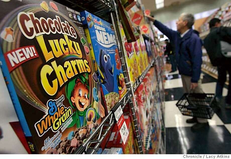 "Cereals such as General Mills ""Lucky Charms"" are new on the shelves containing Whole Grain, as Bill Allen chooses ""All Bran"" at Andronicos MArket, in Berkeley Jan. 24, 2005.Manufactures such as General Mills are making cereals and breads with Whole Grain to entice buyers to think they are eating healthy. Produces are on the shelf of Andronico's Market in Berkeley, Jan. 24 2005.  LACY ATKINS/SAN FRANCISCO CHRONICLE Photo: LACY ATKINS"