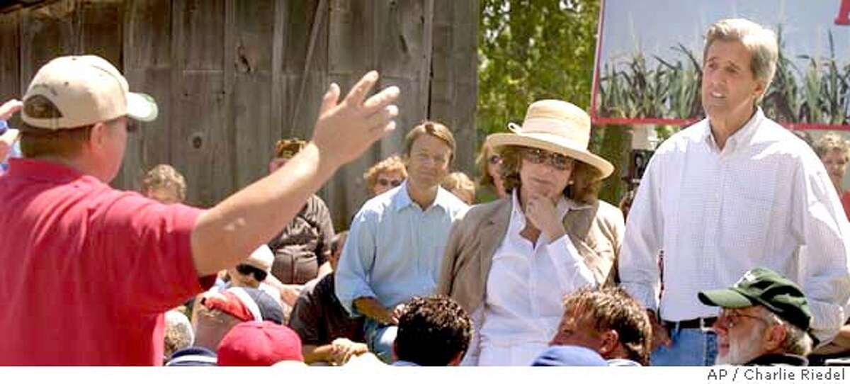 From left Democratic vice presidential nominee Sen. John Edwards, D-N.C., presidential nominee Sen. John Kerry, D-Mass. and Kerry's wife Theresa Heinz Kerry listen to a question by a hog farmer during an appearance at a farm near Smithville, Mo. Friday, Aug. 6, 2004. (AP Photo/Charlie Riedel)